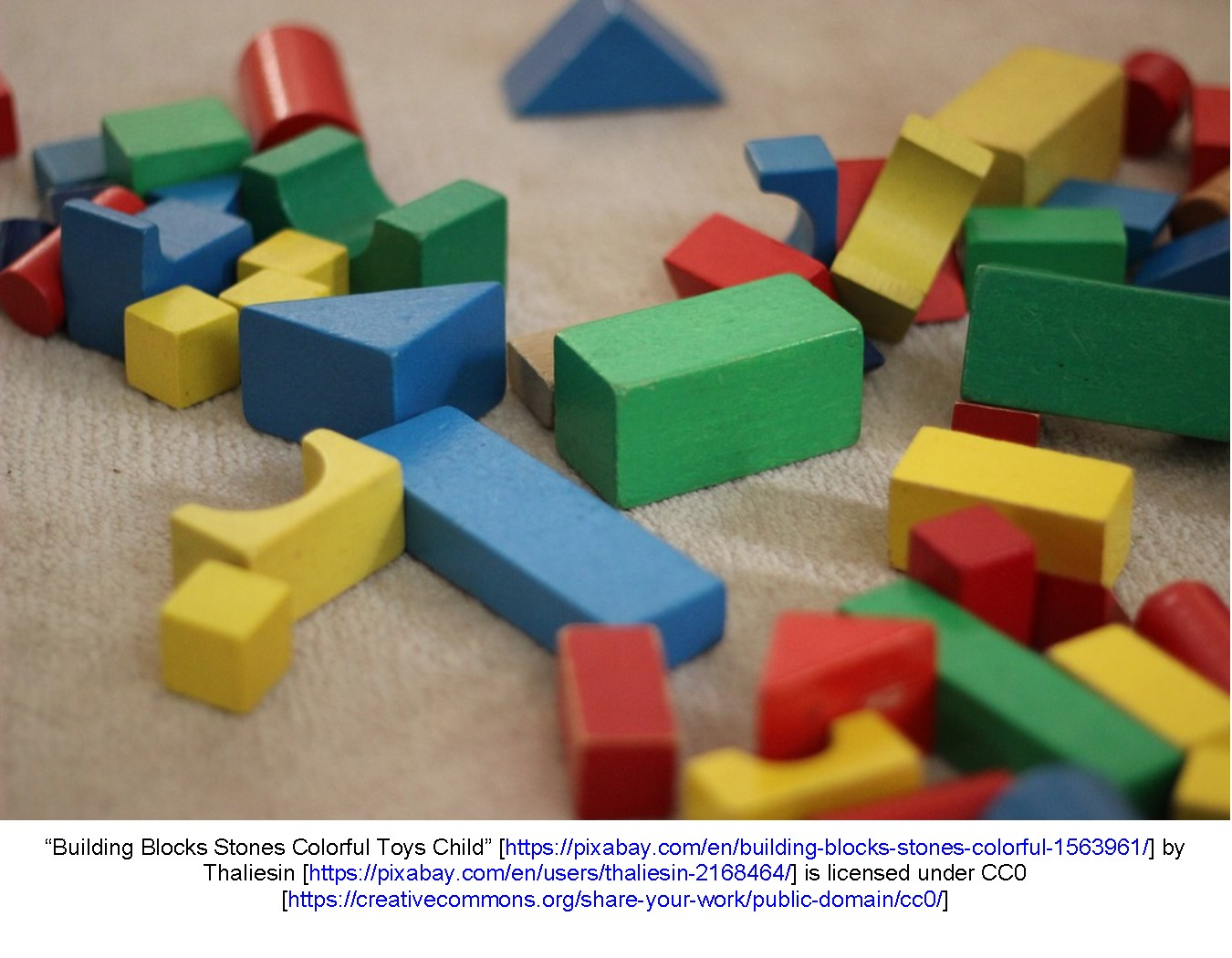 Colorful wooden blocks scattered on the floor