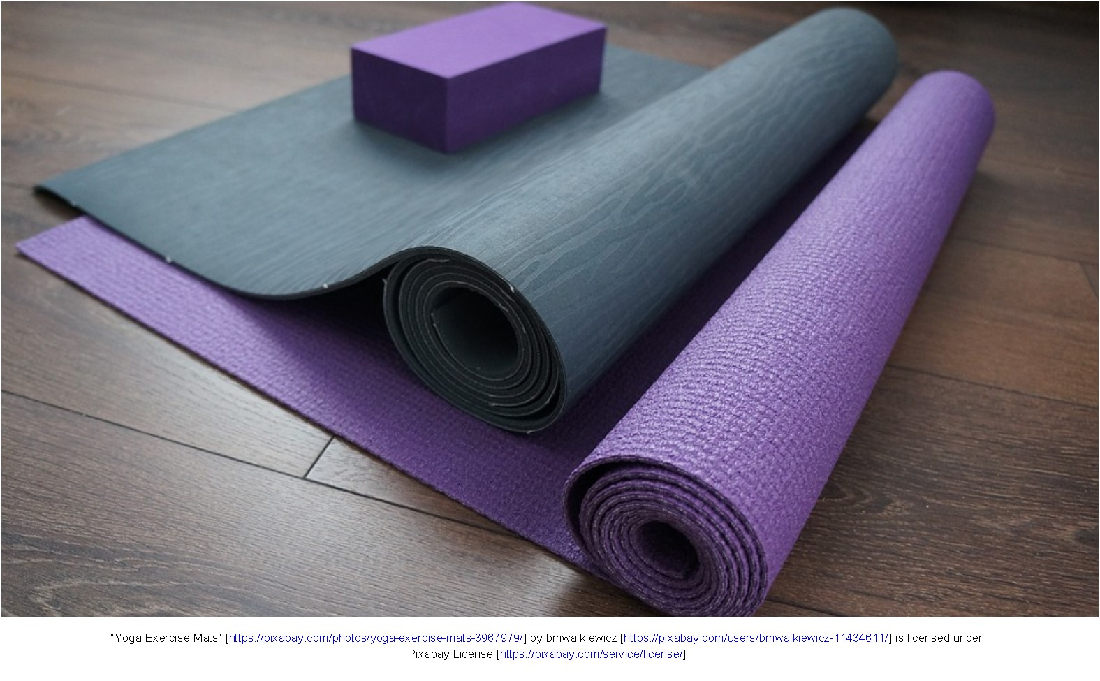 Two yoga mats with a yoga block