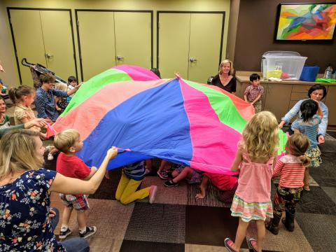 kids and parachute at library