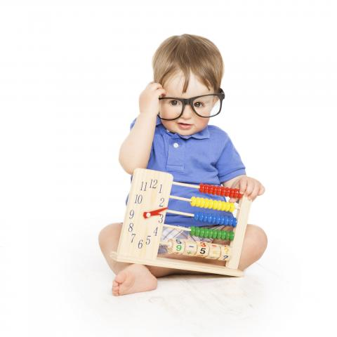 baby with glasses and toy