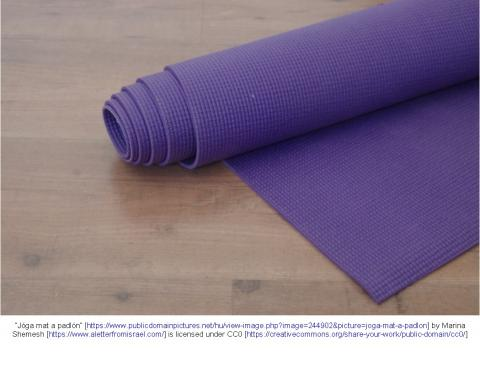 Rolled purple yoga mat