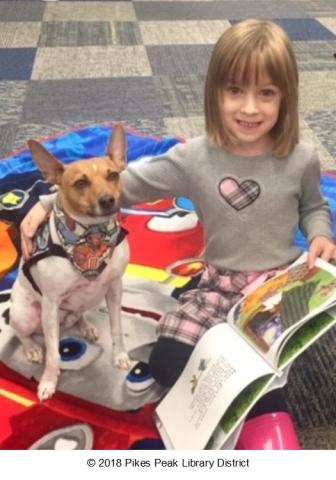 Patron reading to Sky, one of our Paws to Read dogs