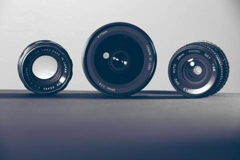 Three manual camera lenses