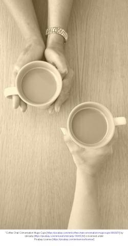 Overhead view of hands holding mugs